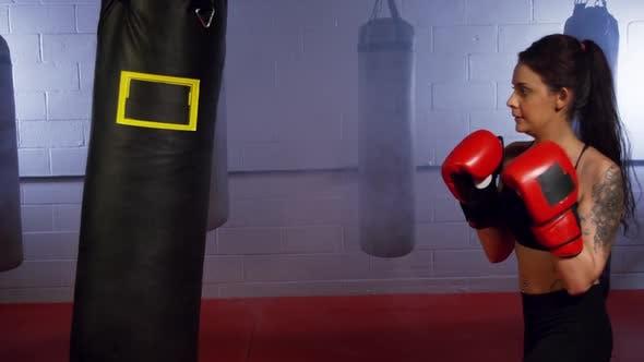 Thumbnail for Beautiful Woman Training Punching Bag 01