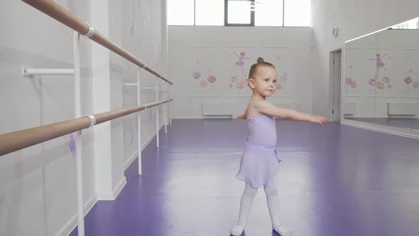 Thumbnail for Cute Little Ballerina in Leotard Whirling in Dance at Ballet School