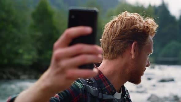 Man Video Chatting on Smartphone