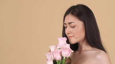Beautiful woman smell flower
