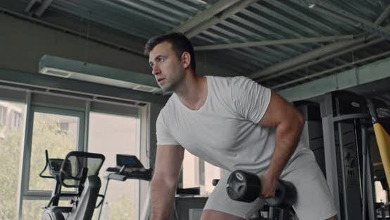 Thumbnail for Athlete Picking Up Dumbbell at Gym, Training Arm Muscles, Slow Motion