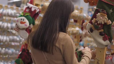 Professional Shopper Holds Christmas Stocking in Hands