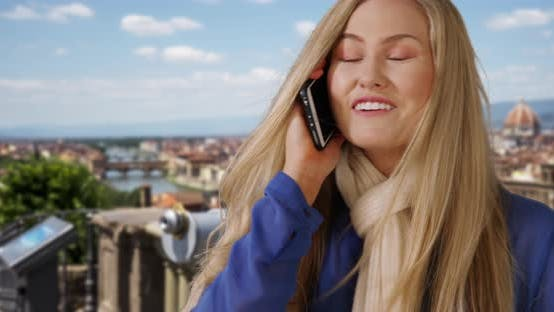 Beautiful white female talking on phone in Florence, Italy