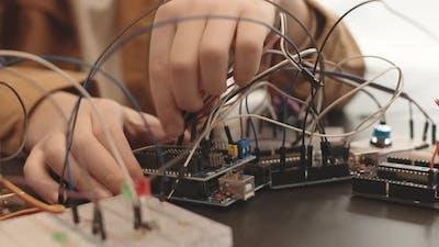 Unrecognizable Child Constructing Robot