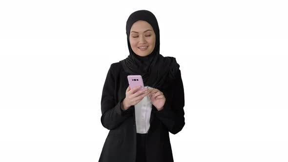 Thumbnail for Smiling Arab Woman Using Smart Phone on White Background
