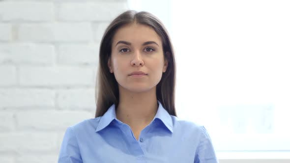 Thumbnail for Serious Woman Looking at Camera in Office