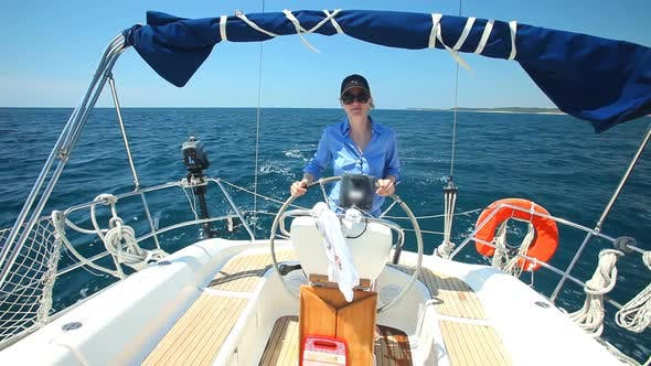 Thumbnail for Woman at wheel steering sailboat on Adriatic sea in Croatia