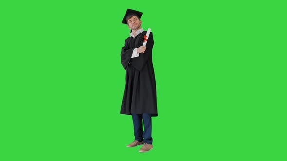 Thumbnail for Happy Male Student in Graduation Robe Posing and Waiving with His Diploma on a Green Screen Chroma