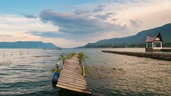 Time lapse lake Toba Samosir Island Sumatra Indonesia old wooden jetty. Lake Tob