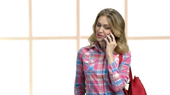 Young Flirty Woman Talking on Cell Phone