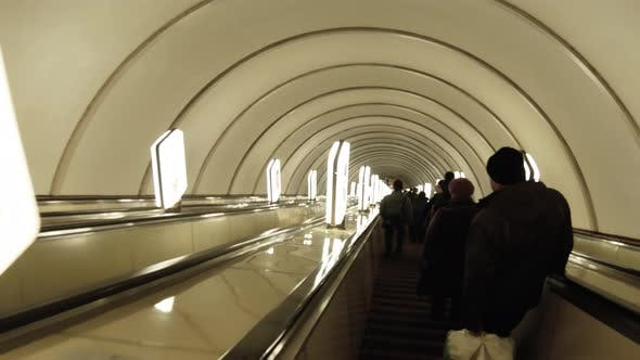 Cover Image for Going Down the Escalator in the Subway, the Movement of People Up and Down, Public Transport. Modern