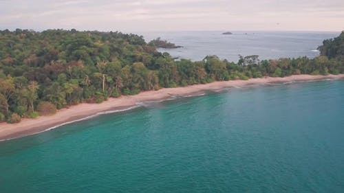 Espadilla South tropical Beach, Manuel Antonio National Park, Costa Rica. Aerial drone view