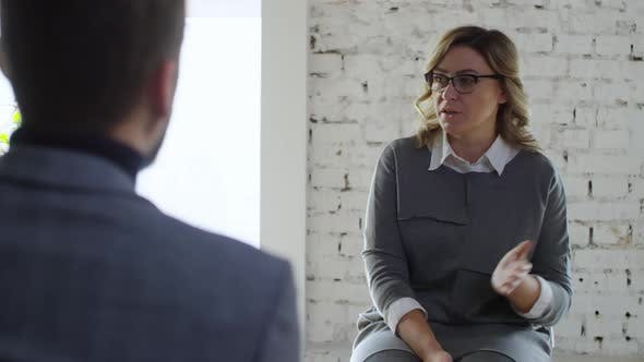 Thumbnail for Mature Woman Talking on Meeting
