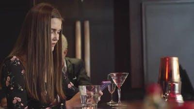 Woman using phone at nightclub restaurant