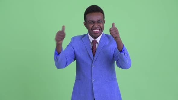 Happy Young African Businessman Giving Thumbs Up and Looking Excited