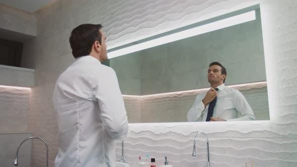 Thumbnail for Business Man Wearing Tie in Luxury Bathroom. Happy Man Dressing Himself in House