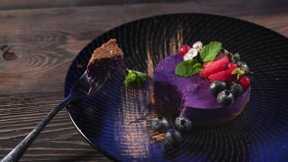 Thumbnail for Piece of Purple Cheesecake on Fork.