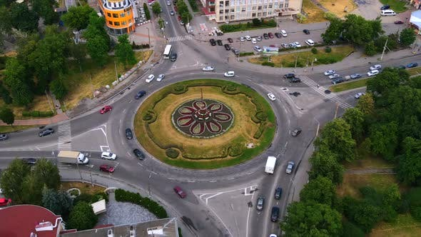 Aerial View Timelapse of Roundabout Road with Circular Cars in Small European City
