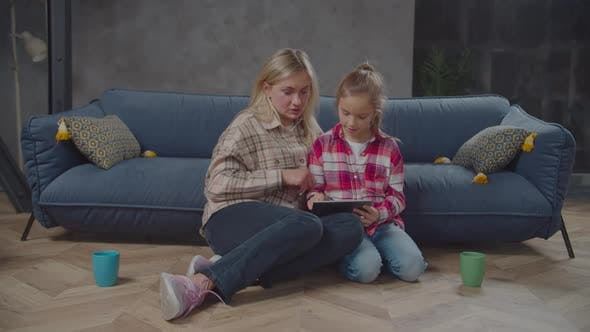 Thumbnail for Lovely Girl and Mom Browsing Online on Tablet Pc