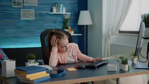 Young Girl Feeling Tired While Learning Online Lessons