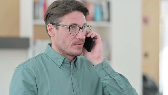 Thumbnail for Busy Middle Aged Man Talking on Phone