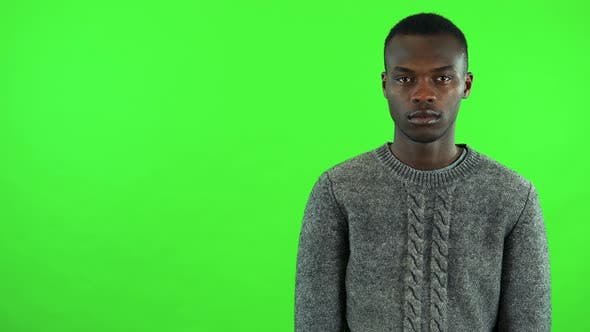 Thumbnail for A Young Black Man Shakes His Head at the Camera - Green Screen Studio