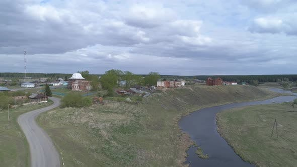 Aerial view of old village with ruined buildings on bank of the river 01