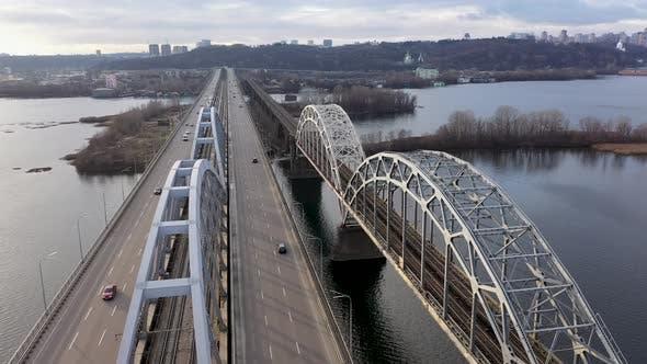 Thumbnail for Aerial View of the Kyiv City, Ukraine, Dnieper River With Bridges, Darnitskiy Bridge