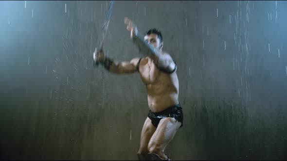 Thumbnail for Wet Shirtless Gladiator Jumping in Attack.