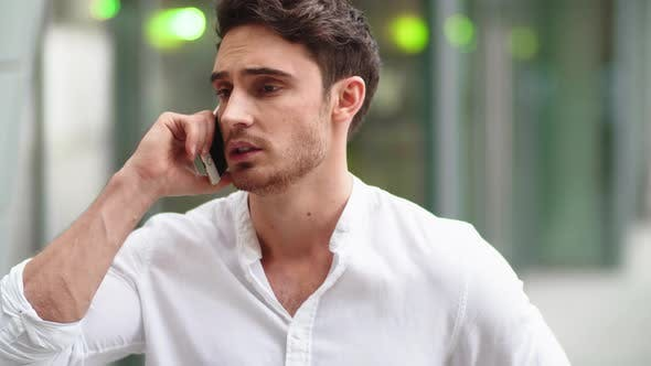 Thumbnail for Closeup Man Talking on Phone Outside. Man Discussing Business on Phone Outdoor