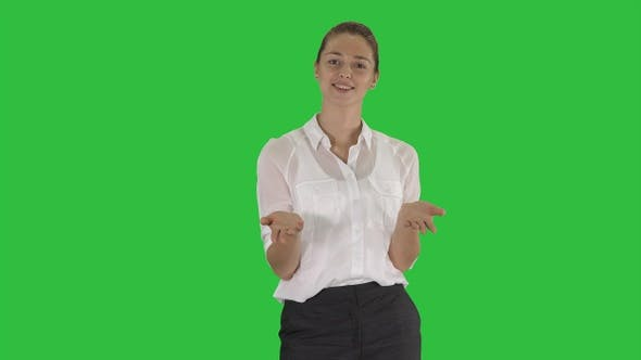 Thumbnail for Woman looking into the camera and talking on a Green Screen