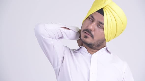 Thumbnail for Face of Stressed Bearded Indian Sikh Businessman Having Neck Pain