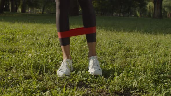 Thumbnail for Female Legs Exercising with Resistance Band in Park
