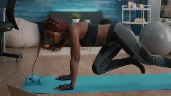 Athletic Slim Black Woman Doing Run Exercise During Morning Fitness Workout