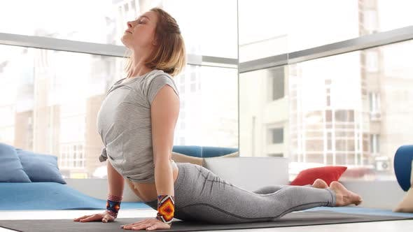 Thumbnail for Portrait of Young Beautiful Young Woman Doing Yoga or Pilates Exercise
