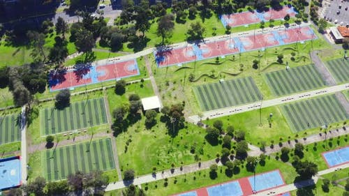 Aerial top down view over many sport fields for soccer and basketball i