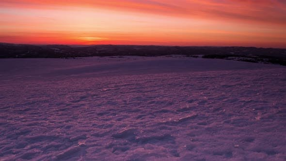 Thumbnail for Timelapse Sunrise Scenery Over Frozen Snowy Plain in Norway at High Attitude