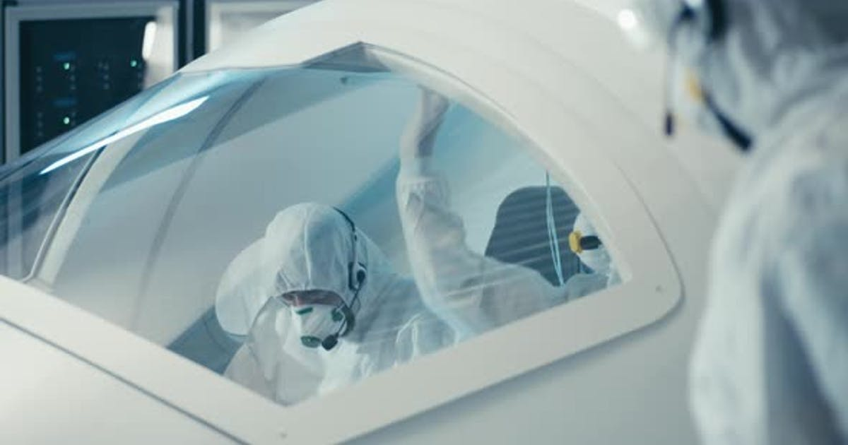 Engineers Working in Clean Room