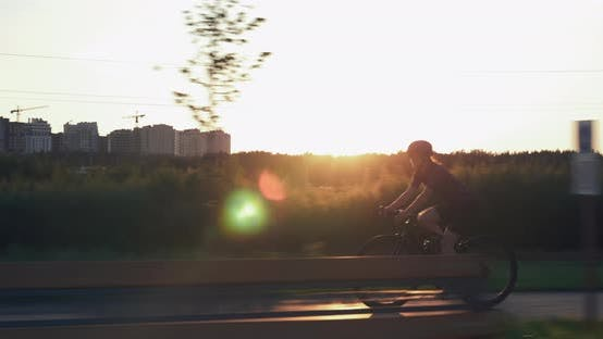 Thumbnail for Pro female cyclist is cycling at sunset, Cycling motivation, Girl rides bike