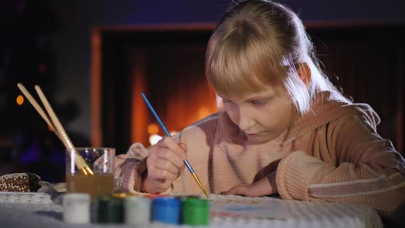Thumbnail for Child Writes a Letter To Santa Claus Near the Fireplace and Christmas Tree