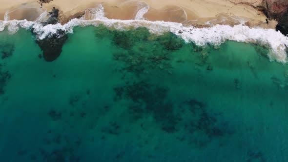 Thumbnail for Aerial View Waves Break on White Sand Beach