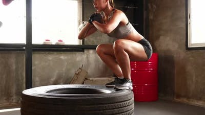 Sporty woman exercising building muscles at the gym
