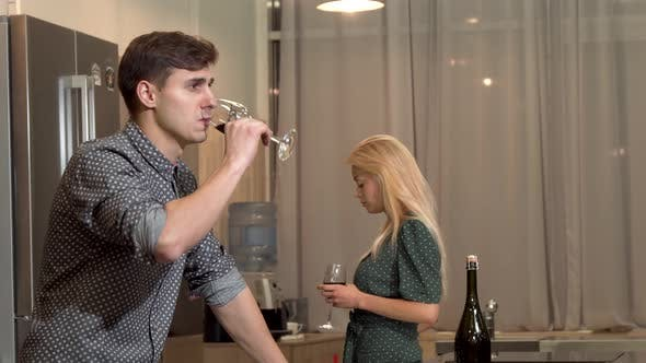 Thumbnail for Handsome Man Drinking Wine After Having a Fight with His Girlfriend at Home