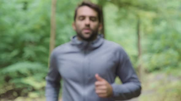 Man Running Into Focus And Wiping Brow