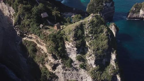 Aerial Fly Over View Of Multiple Tree House Hostels on Cliff