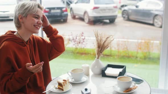 Thumbnail for Girl in Orange Hoodie Is Telling a Story To Other Girl