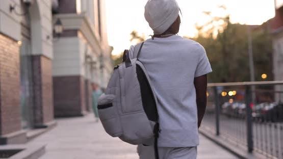 African American Man Walking in a City Street Slow Motion