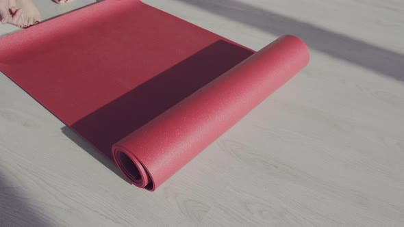 Thumbnail for Young Woman Rolling Black Fitness or Yoga Mat Before or After Sport Practice, Working Out at Home in