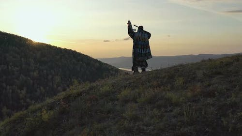 Steadicam Shot of the Forest Sorcerer Knocking on His Tambourine.