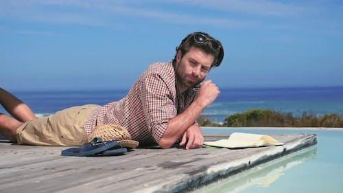 Man lying down by pool